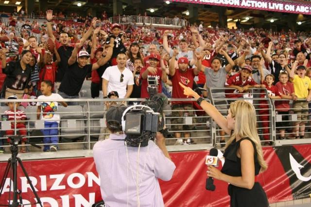 Carey Pena rallies the crowd at the Arizona Cardinals game